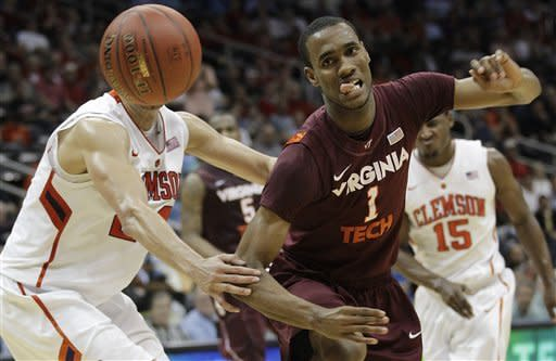 Clemson forward Milton Jennings (24) works against Virginia Tech guard Robert Brown (1) during the first half of an NCAA college basketball game in the first round of the Atlantic Coast Conference men's tournament, Thursday, March 8, 2012, in Atlanta. (AP Photo/Chuck Burton)