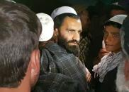 A newly freed Taliban prisoner hugs his relatives outside Bagram prison, north of Kabul