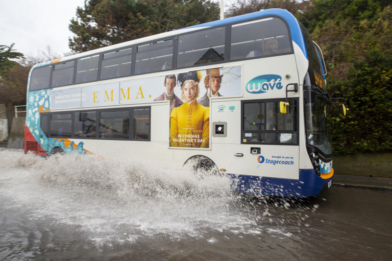 A stagecoach local bus drives down the A259 between Folkestone and Hythe which is flooded at Sandgate, Kent on the south coast of England, as Storm Ciara continues to sweep over the country on February 10th 2020 in Folkestone, United Kingdom. Amber weather warnings were put into place by the MET office as gusts of up to 90mph and heavy rain swept across the UK. An amber warning from the MET office expects a powerful storm that will disrupt air, rail and sea links travel, cancel sports events, cut electrical power and damage property. (photo by Andrew Aitchison / In pictures via Getty Images)