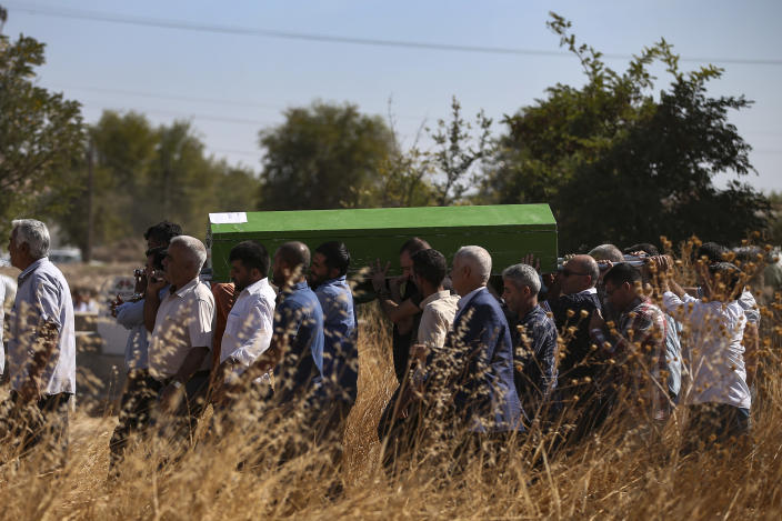 Mourners carry the coffin of Halil Yagmur, 64 killed Friday during mortar shelling from Syria, during a funeral procession in the town of Suruc, southeastern Turkey, at the border with Syria, Saturday, Oct. 12, 2019. Turkey says its military offensive has taken central Ras al-Ayn, a key border town in northeastern Syria, and its most significant gain since its cross-border operation began against Syrian Kurdish fighters began. (AP Photo/Emrah Gurel)