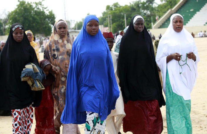 """Nigeria Muslim women attend Eid al-Fitr prayers at Ramat square in Maiduguri, Nigeria, Thursday, Aug. 8, 2013. Nigerians in the birthplace of an Islamic uprising gripping the northeast Thursday celebrated the Muslim holy day of Eid al-Fitr with devout prayers and a joyful show of adulation for their king that attracted more than 10,000 people. It was the first durbar in three years in the city of Maiduguri and the joy that it could take place _ albeit amid massive security _ was heard in the cries of ululating women, screams of delight from children and men chanting """"Long live the king!"""" (AP Photo/Sunday Alamba)"""