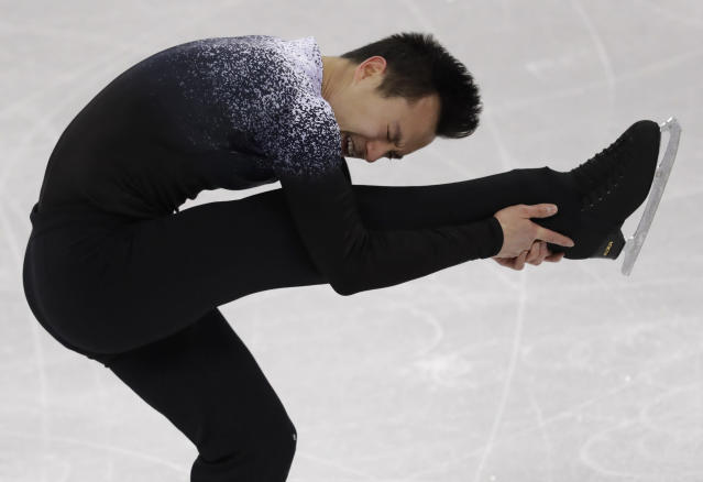 Patrick Chan of Canada performs during the men's short program figure skating in the Gangneung Ice Arena at the 2018 Winter Olympics in Gangneung, South Korea, Friday, Feb. 16, 2018. (AP Photo/Bernat Armangue)