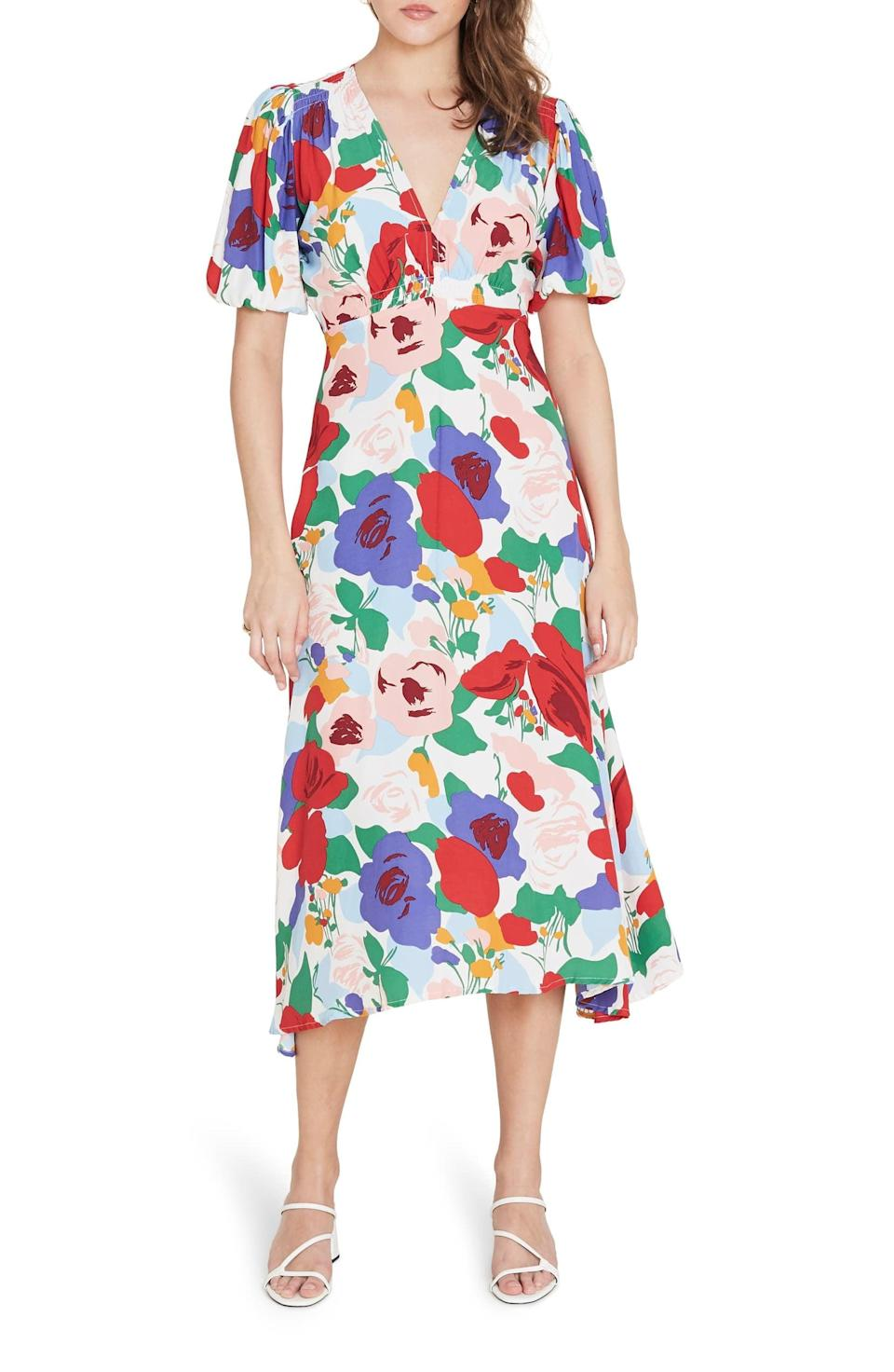 "<p>The print on this <a href=""https://www.popsugar.com/buy/Faithfull-Brand-Vittoria-Floral-Midi-Dress-546038?p_name=Faithfull%20the%20Brand%20Vittoria%20Floral%20Midi%20Dress&retailer=shop.nordstrom.com&pid=546038&price=189&evar1=fab%3Aus&evar9=47237816&evar98=https%3A%2F%2Fwww.popsugar.com%2Fphoto-gallery%2F47237816%2Fimage%2F47237874%2FFaithfull-Brand-Vittoria-Floral-Midi-Dress&list1=shopping%2Cdresses%2Cspring%20fashion&prop13=api&pdata=1"" class=""link rapid-noclick-resp"" rel=""nofollow noopener"" target=""_blank"" data-ylk=""slk:Faithfull the Brand Vittoria Floral Midi Dress"">Faithfull the Brand Vittoria Floral Midi Dress </a> ($189) is so cheerful.</p>"