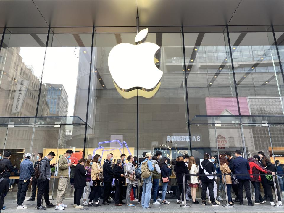 Shanghai/China-Nov.2020: Chinese customers in face mask, lining up outside Apple retail store, queuing to buy the new iPhone