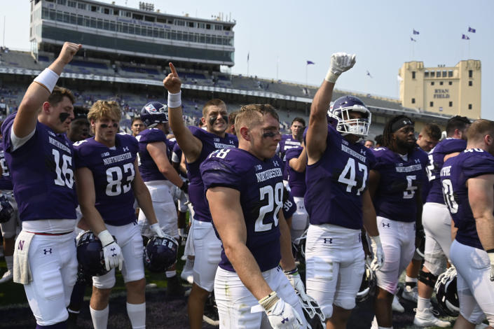 Northwestern players celebrate after an NCAA college football game against Indiana State in Evanston, Ill., Saturday, Sept. 11, 2021. (AP Photo/Matt Marton)