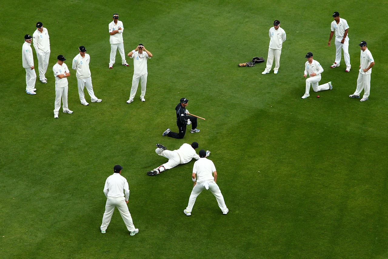 WELLINGTON, NEW ZEALAND - DECEMBER 12:  New Zealand players warm up after a rain delay during day two of the Second Test match between New Zealand and the West Indies at Basin Reserve on December 12, 2013 in Wellington, New Zealand.  (Photo by Hagen Hopkins/Getty Images)