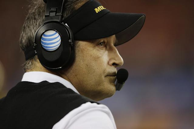 Missouri head coach Gary Pinkel watches the action against Oklahoma State during the second half of the Cotton Bowl NCAA college football game on Friday, Jan. 3, 2014, in Arlington, Texas. (AP Photo/Tim Sharp)