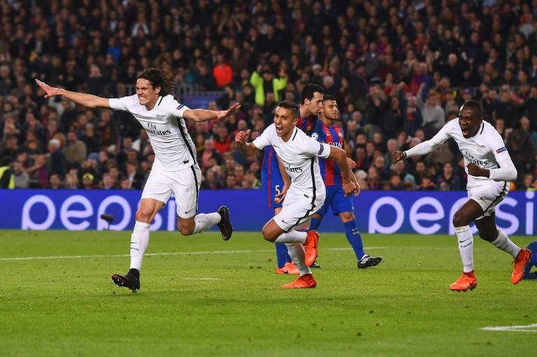 Paris Saint-Germain's Edinson Cavani (L) celebrates after scoring a goal during their UEFA Champions League round of 16 2nd leg match against Barcelona, at Camp Nou stadium in Barcelona, on March 8, 2017