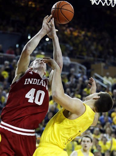 Indiana forward Cody Zeller (40) and Michigan forward Mitch McGary (4) chase a rebound during the first half of an NCAA college basketball game Sunday, March 10, 2013, in Ann Arbor, Mich. (AP Photo/Duane Burleson)