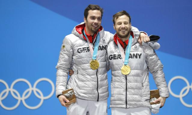 Medals Ceremony - Luge - Pyeongchang 2018 Winter Olympics - Men's Doubles - Medals Plaza - Pyeongchang, South Korea - February 16, 2018 - Gold medalists Tobias Wendl and Tobias Arlt of Germany on the podium. REUTERS/Eric Gaillard