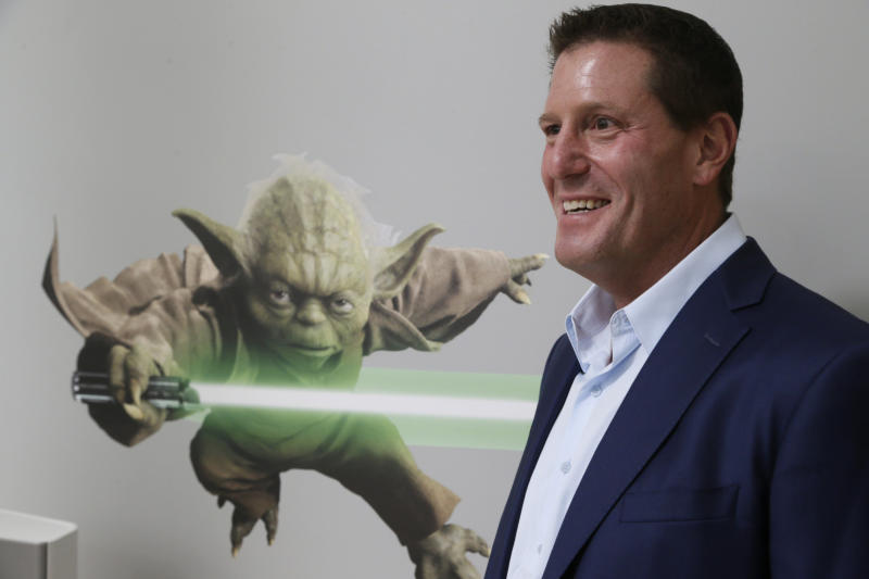 "In this July 13, 2015 file photo, Disney chief strategy officer Kevin Mayer visits the company's ""accelerator"" space in Glendale, Calif.  Mayer will also be chief operating officer of TikTok's Chinese parent company, ByteDance, and report to its founder and CEO, Yiming Zhang, the company announced Monday, May 18, 2020. TikTok's app features short videos, many with music and dancing, that has become a favorite of younger people and is known for its goofy, light-hearted feel. (AP Photo/Damian Dovarganes, file)"