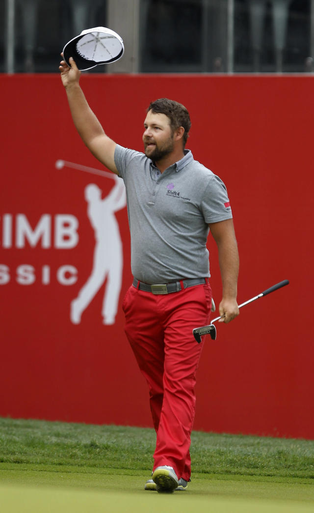 Ryan Moore of the U.S. acknowledges the crowd after winning in a playoff of the CIMB Classic golf tournament at the Kuala Lumpur Golf and Country Club in Kuala Lumpur, Malaysia, Monday, Oct. 28, 2013. (AP Photo/Lai Seng Sin)