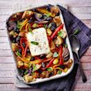 """<p>Bring a taste of holiday sunshine to your kitchen with this traybake inspired by the flavours of a Greek salad. Unlike most cheeses, feta doesn't go gooey when baked, instead it goes tender, yielding and delicately caramelised at the edges.</p><p><strong>Recipe: <a href=""""https://www.goodhousekeeping.com/uk/food/recipes/a36531624/greek-salad-feta-traybake/"""" rel=""""nofollow noopener"""" target=""""_blank"""" data-ylk=""""slk:Greek Salad Feta Traybake"""" class=""""link rapid-noclick-resp"""">Greek Salad Feta Traybake</a></strong></p>"""