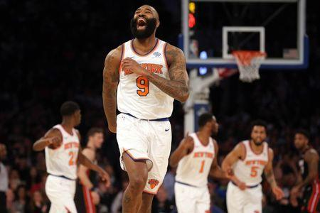 FILE PHOTO - Apr 6, 2018; New York, NY, USA; New York Knicks center Kyle O'Quinn (9) reacts after a three point basket against the Miami Heat during the second quarter at Madison Square Garden. Mandatory Credit: Brad Penner-USA TODAY Sports - 10770938