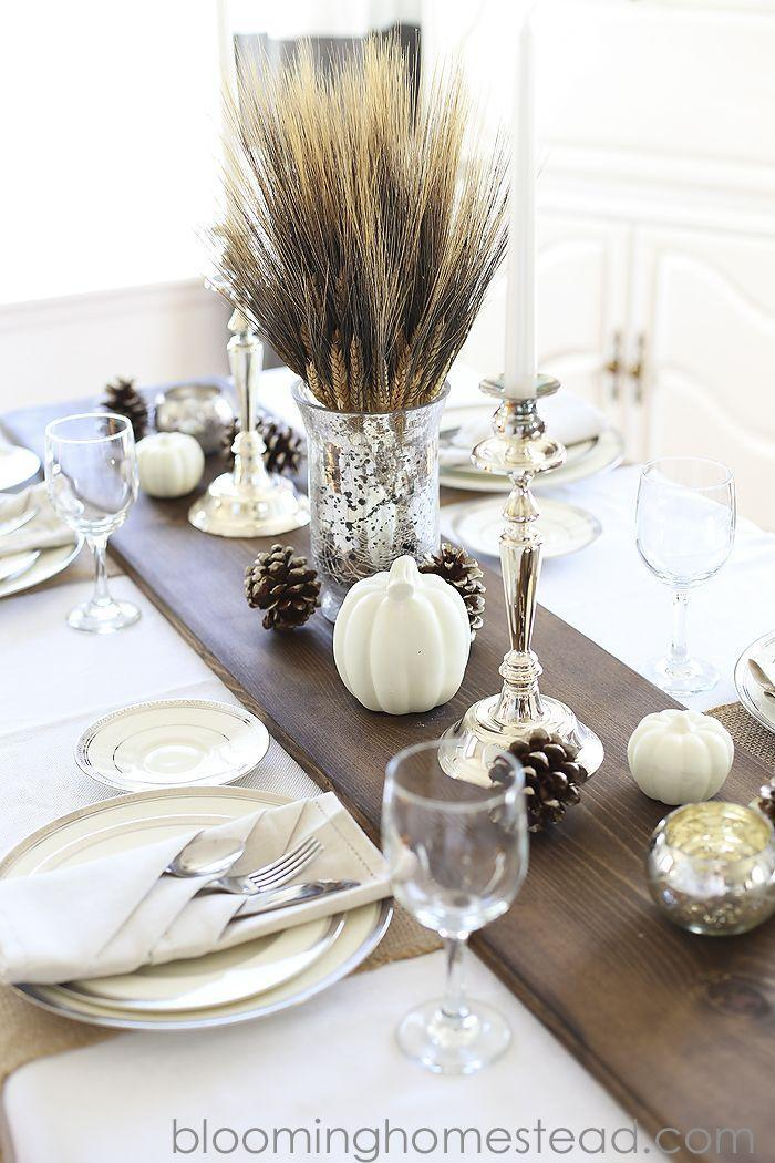 """<p>Metallic candle holders, frosted pinecones, and white pumpkins stand out against a dark stained wood table runner.</p><p><strong>Get the tutorial at <a href=""""http://www.bloominghomestead.com/2014/11/diy-rustic-wood-table-runner.html"""" rel=""""nofollow noopener"""" target=""""_blank"""" data-ylk=""""slk:Blooming Homestead"""" class=""""link rapid-noclick-resp"""">Blooming Homestead</a>.</strong></p><p><strong><strong><a class=""""link rapid-noclick-resp"""" href=""""https://www.amazon.com/Elanze-Designs-Decorative-Pumpkins-Quantity/dp/B07CHVVC1S?tag=syn-yahoo-20&ascsubtag=%5Bartid%7C10050.g.2130%5Bsrc%7Cyahoo-us"""" rel=""""nofollow noopener"""" target=""""_blank"""" data-ylk=""""slk:SHOP FAUX WHITE PUMPKINS"""">SHOP FAUX WHITE PUMPKINS</a></strong><br></strong></p>"""