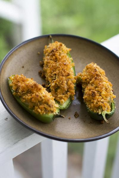 In this image taken on May 20, 2013, cheesy sausage-stuffed jalapeno peppers are displayed in Concord, N.H. (AP Photo/Matthew Mead)