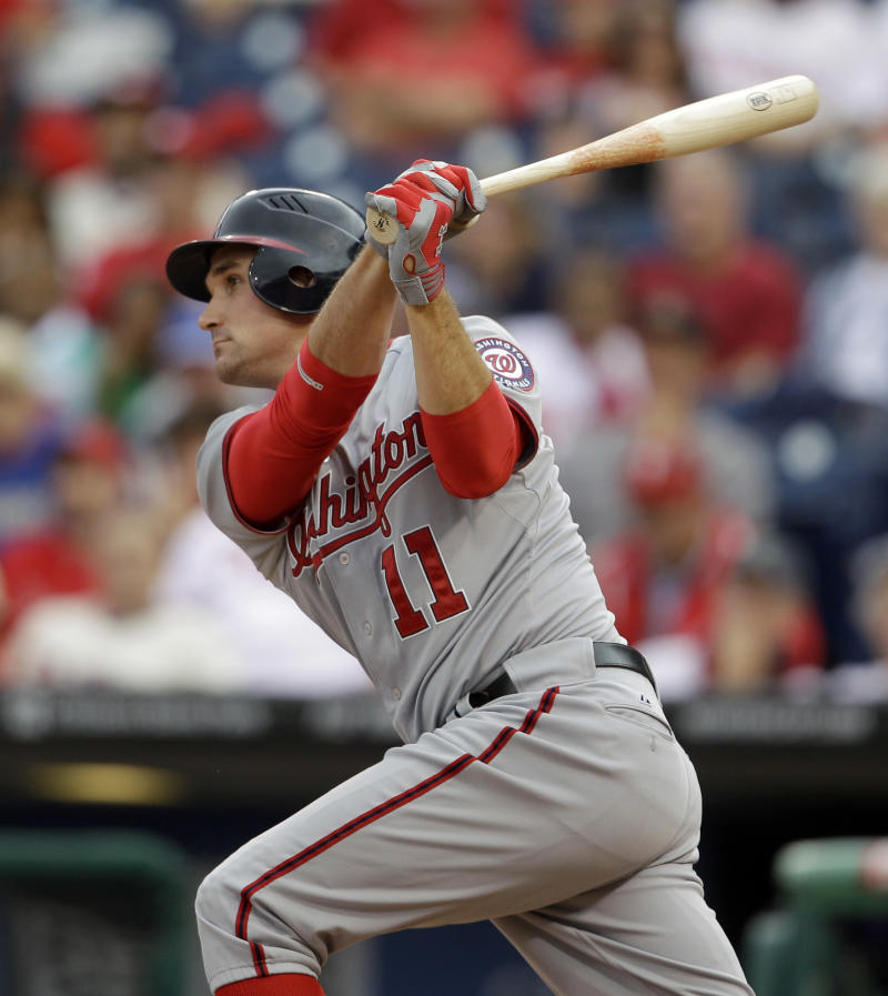 Washington Nationals' Ryan Zimmerman follows through after hitting the go-ahead  RBI single off Philadelphia Phillies relief pitcher Michael Stutes during the tenth inning of the first game a baseball doubleheader, Tuesday, Sept. 20, 2011, in Philadelphia. Washington won 4-3 in ten innings. (AP Photo/Matt Slocum)
