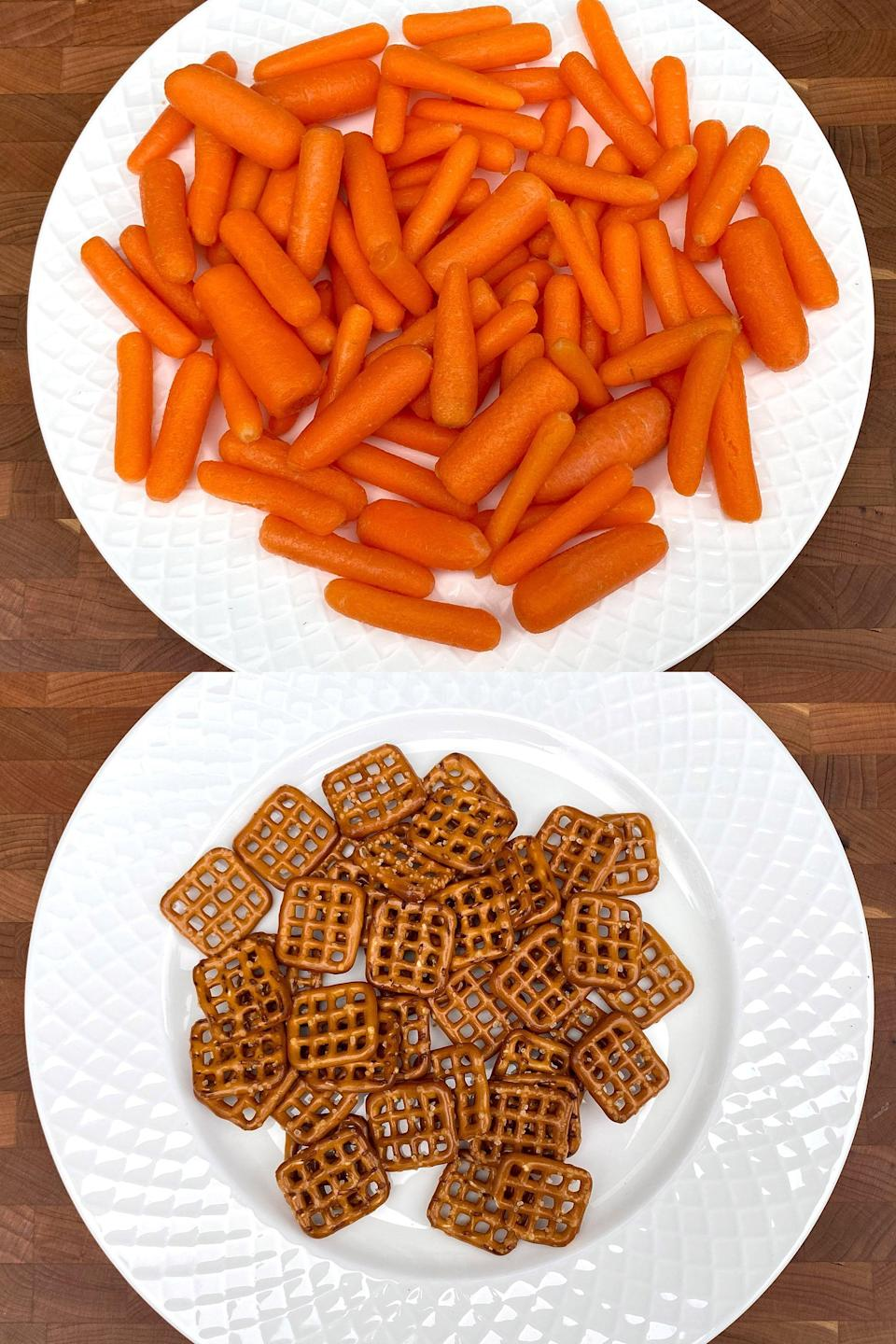 <p>Which do you think would fill you up more for a snack? This is 81 baby carrots for 200 calories versus only 40 pretzels. You'd probably be more likely to eat half those carrots anyway, which would be half the calories.</p>