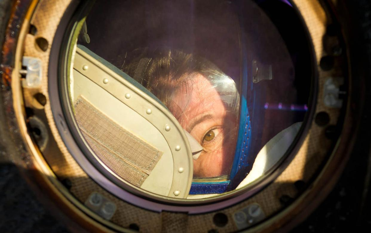 Expedition 27 Flight Engineer Cady Coleman peeks out of a window of the Soyuz TMA-20 spacecraft shortly after she and Commander Dmitry Kondratyev and Flight Engineer Paolo Nespoli landed southeast of the town of Zhezkazgan, Kazakhstan, on Tuesday, May 24, 2011. NASA Astronaut Coleman, Russian Cosmonaut Kondratyev and Italian Astronaut Nespoli are returning from more than five months onboard the International Space Station where they served as members of the Expedition 26 and 27 crews. Photo Credit: (NASA/Bill Ingalls)