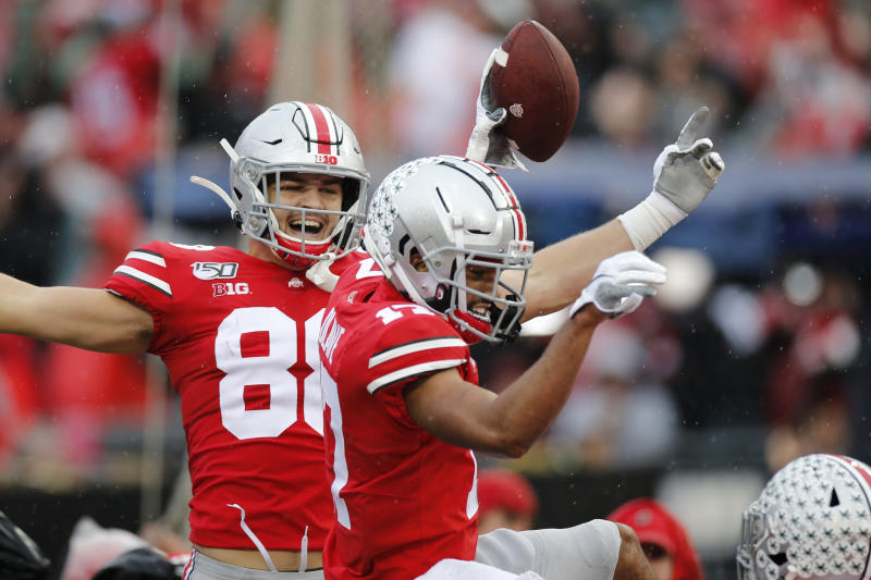 Ohio State receiver Chris Olave, right, celebrates his touchdown against Wisconsin with teammate Jeremy Ruckert during the first half of an NCAA college football game Saturday, Oct. 26, 2019, in Columbus, Ohio. (AP Photo/Jay LaPrete)