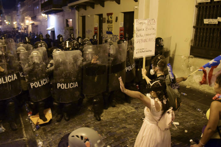 A demonstrator reacts in front of the police during clashes near the executive mansion  during clashes near the executive mansion demanding the resignation of Gov. Ricardo Rossello, in San Juan, Puerto Rico, Wednesday, July 17, 2019.  (Photo: Carlos Giusti/AP)