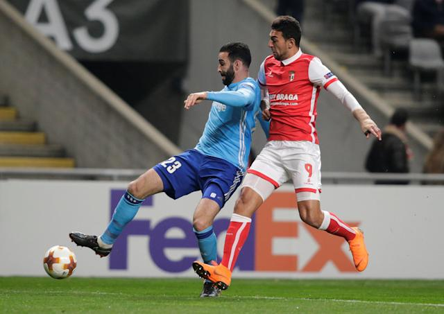 Soccer Football - Europa League Round of 32 Second Leg - S.C. Braga vs Olympique de Marseille - Estadio Municipal de Braga, Braga, Portugal - February 22, 2018 Marseille's Adil Rami in action with Sporting Braga's Ahmed Mahgoub REUTERS/Miguel Vidal