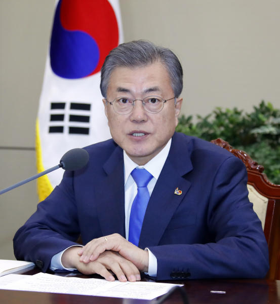 South Korean President Moon Jae-in presides over a meeting of the National Security Council at the presidential Blue House in Seoul, South Korea, Monday, March 4, 2019. Moon said Seoul will actively try to get the nuclear negotiations between Washington and Pyongyang quickly back on track. (Bae Jae-man/Yonhap via AP)