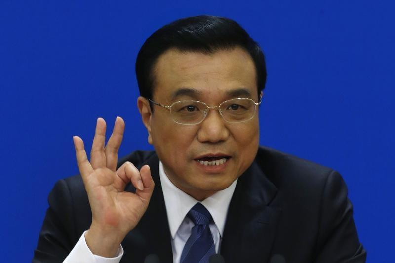 China's Premier Li Keqiang gestures as he speaks during a news conference, after the closing ceremony of the Chinese National People's Congress at the Great Hall of the People, in Beijing