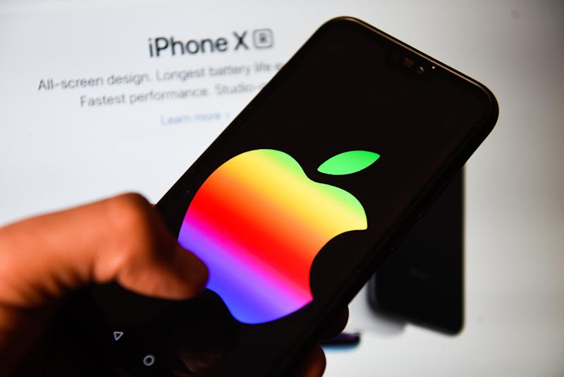 POLAND - 2019/06/09: In this photo illustration an Apple logo with rainbow colors seen displayed on a smart phone. (Photo Illustration by Omar Marques/SOPA Images/LightRocket via Getty Images)