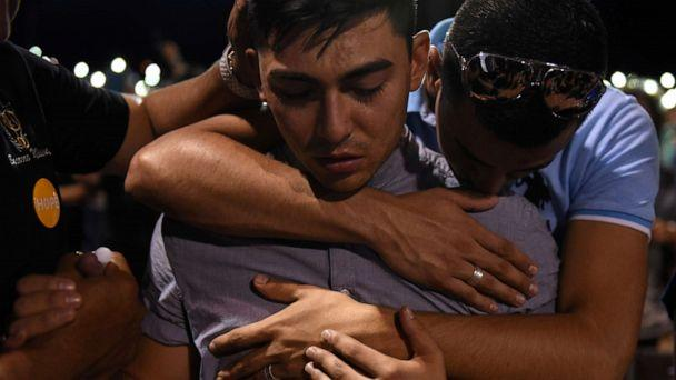 PHOTO: A group of men embrace during a vigil a day after a mass shooting at a Walmart store in El Paso, Texas, Aug. 4, 2019. (Callaghan O'hare/Reuters)