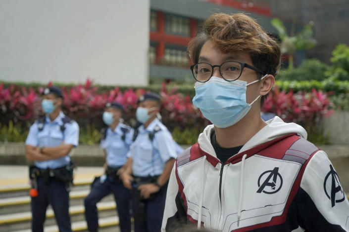 """Various defendants including pro-democracy activist Figo Chan Ho-wun arrives at a court in Hong Kong, Monday, May 17, 2021. Trial starts for Jimmy Lai and nine others, accused of """"incitement to knowingly take part in an unauthorized assembly"""" for a protest march on 1 October 2019. The court has estimated 10 days for this trial. (AP Photo/Kin Cheung)"""