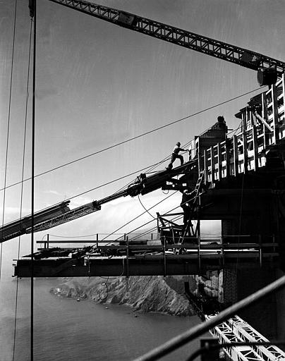 Workers at the top of the tower, which will support the $35,000,000 suspension bridge, are shown during construction of one of the catwalks for the Golden Gate Bridge in San Francisco, Ca., Oct. 17, 1935. Below in background is the Marin County shore, which will be connected to San Francisco by the bridge. (AP Photo)