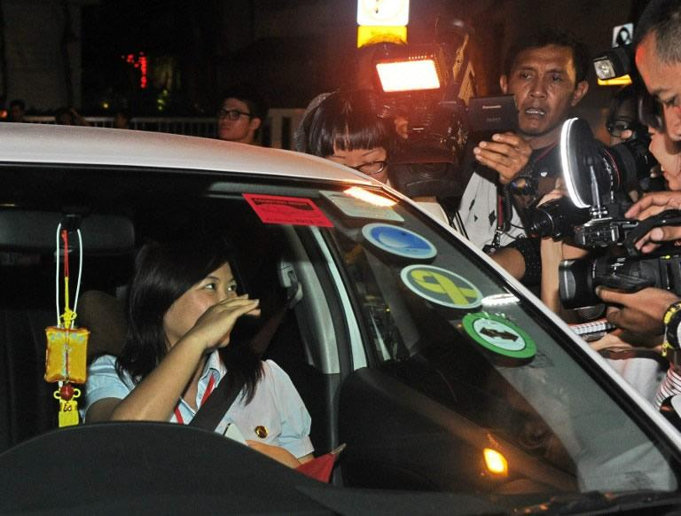 Workers' Party candidate Lee Li Lian arrives in a car (L) at the counting centre in Singapore.