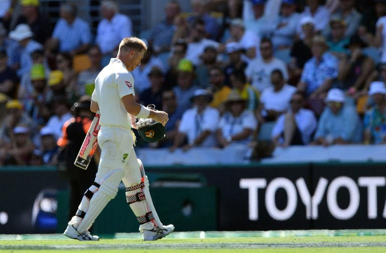 Australia's David Warner walks off after being dismissed on the second day of their first Ashes Test match, in Brisbane, on November 24, 2017