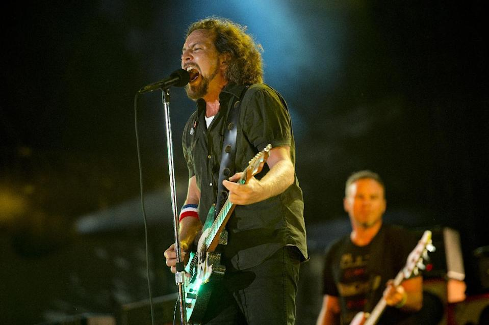"""FILE - In this Sept. 2, 2012, file photo, Pearl Jam performs at the """"Made In America"""" music festival in Philadelphia. The Seattle-based rockers and the late rapper Tupac Shakur lead a class of Rock and Roll Hall of Fame inductees that also include folkie Joan Baez and 1970s favorites Journey, Yes and Electric Light Orchestra. The hall's 32nd annual induction ceremony will take place on April 7, 2016, at Barclays Center in Brooklyn, N.Y. (Photo by Drew Gurian/Invision/AP, File)"""