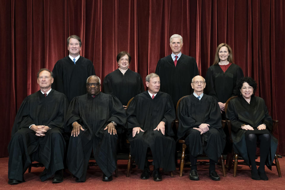 FILE - In this April 23, 2021, file photo, members of the Supreme Court pose for a group photo at the Supreme Court in Washington. Seated from left are Associate Justice Samuel Alito, Associate Justice Clarence Thomas, Chief Justice John Roberts, Associate Justice Stephen Breyer and Associate Justice Sonia Sotomayor, Standing from left are Associate Justice Brett Kavanaugh, Associate Justice Elena Kagan, Associate Justice Neil Gorsuch and Associate Justice Amy Coney Barrett. As congressional Democrats gear up for another bruising legislative push to expand voting rights, much of their attention has quietly focused on a small yet crucial voting bloc with the power to scuttle their plans: the nine Supreme Court justices. (Erin Schaff/The New York Times via AP, Pool)