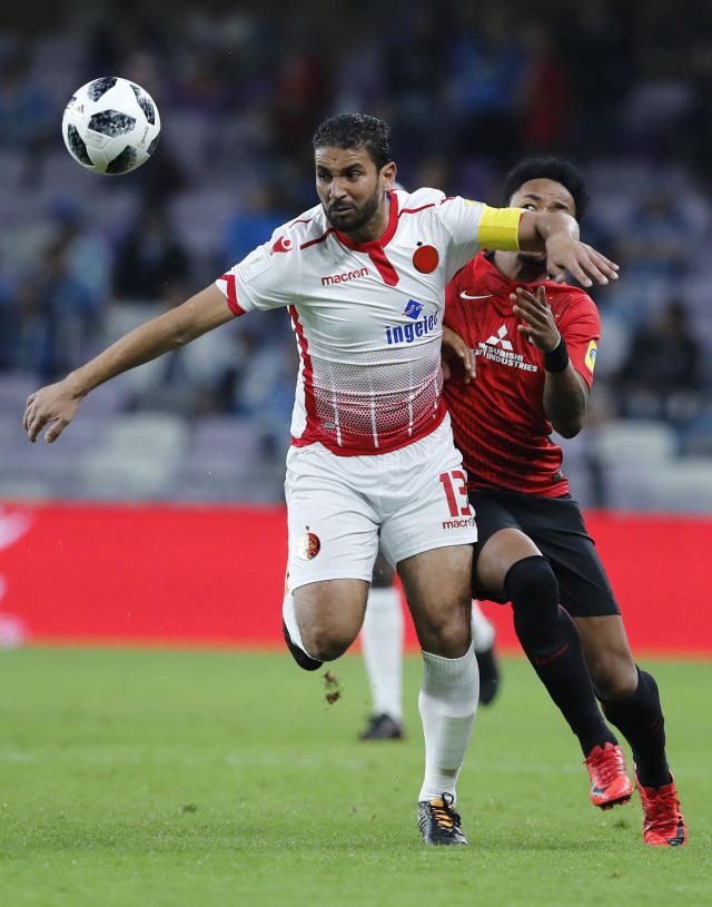 Morocco's Wydad Athletic Club Youssef Rabeh gets away from Japan's Urawa Reds Rafael Silva during the Club World Cup soccer match for the fifth place between Wydad Athletic Club and Urawa Reds at the Hazza Bin Zayed stadium in Al Ain, United Arab Emirates, Tuesday, Dec. 12, 2017. (AP Photo/Hassan Ammar)