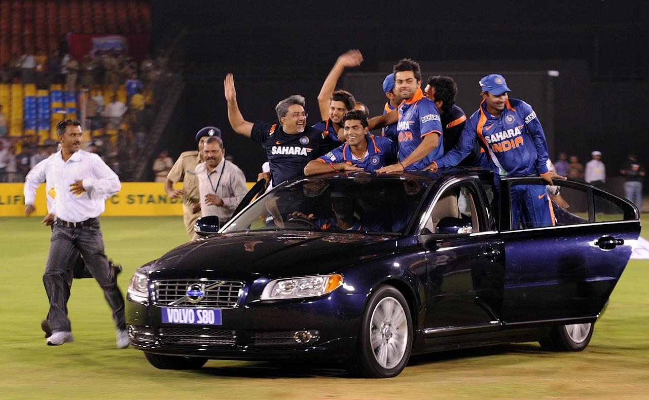 The Indian cricket team take victory lap of the stadium in a car presented to Sachin Tendulkar, India's legendary batsman, after the third and final One Day International match between Indian and South Africa in Ahmedabad on February 27, 2010. India won the series 2-1.  