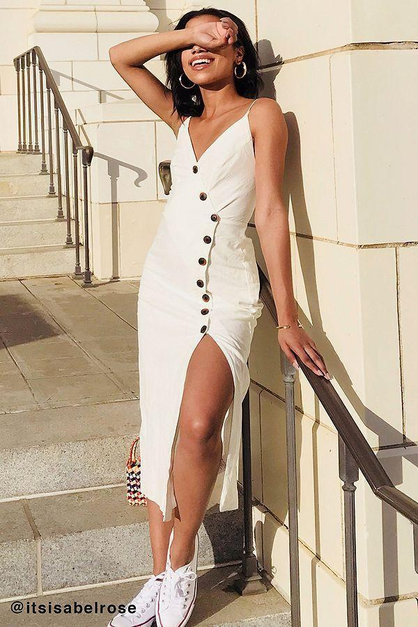 Spontaneous smiling may be a side effect of this perfect dress. Available in sizes XS to XL.