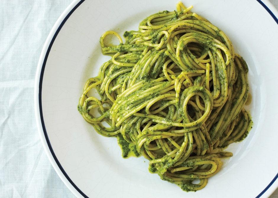 """This recipe makes more pesto than you'll need. Serve the extra with vegetables or fish, or spread it on sandwiches. <a href=""""https://www.bonappetit.com/recipe/ligurian-pesto-with-spaghetti?mbid=synd_yahoo_rss"""" rel=""""nofollow noopener"""" target=""""_blank"""" data-ylk=""""slk:See recipe."""" class=""""link rapid-noclick-resp"""">See recipe.</a>"""