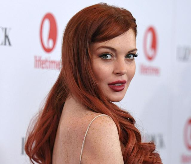 """FILE - In this Nov. 20, 2012 photo, actress Lindsay Lohan attends a dinner celebrating the premiere of """"Liz & Dick"""" at the Beverly Hills Hotel in Beverly Hills, Calif. Lohan is under arrest and charged with third-degree assault Thursday, Nov. 29, 2012 after police say she hit a woman during an argument at a New York City nightclub. (Photo by John Shearer/Invision/AP, File)"""