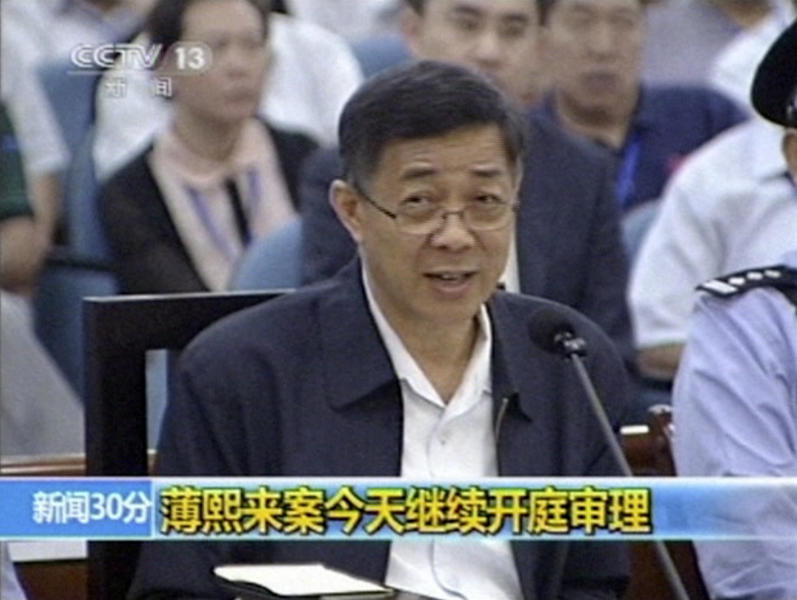 In this image taken from video, former Chinese politician Bo Xilai addresses a court at Jinan Intermediate People's Court in eastern China's Shandong province, Saturday, Aug. 24, 2013. Disgraced politician Bo on Saturday mocked a former city official's testimony that he embezzled government funds with a phone call to his wife, refuting the latest allegation in a politically charged trial that's laid bare tales of greed, machinations and betrayal in one of China's elite families. The superimposed letters read: Bo Xilai case continues with open court trial. (AP Photo/CCTV via AP Video) CHINA OUT, TV OUT