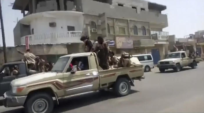 In this frame grab from video provided by Yemen Today, Yemeni army vehicles enter Zinjibar, Yemen, Wednesday, Aug. 28, 2019. Yemeni officials and local residents say forces loyal to the country's internationally recognized government have wrested control of the capital of southern Abyan province from separatists backed by the United Arab Emirates. They say government forces on Wednesday pushed the UAE-backed militia, known as the Security Belt, out of Zinjibar after clasher that left at least one dead and 30 wounded fighters. (Yemen Today via AP)
