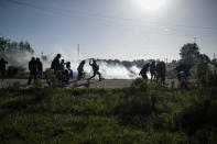 People fight back as police carry out evictions at their squatters camp in Guernica, Buenos Aires province, Argentina, Thursday, Oct. 29, 2020. A court ordered the eviction of families who have been squatting at the camp since July, but the families say they have nowhere to go amid the COVID-19 pandemic. (AP Photo/Natacha Pisarenko)