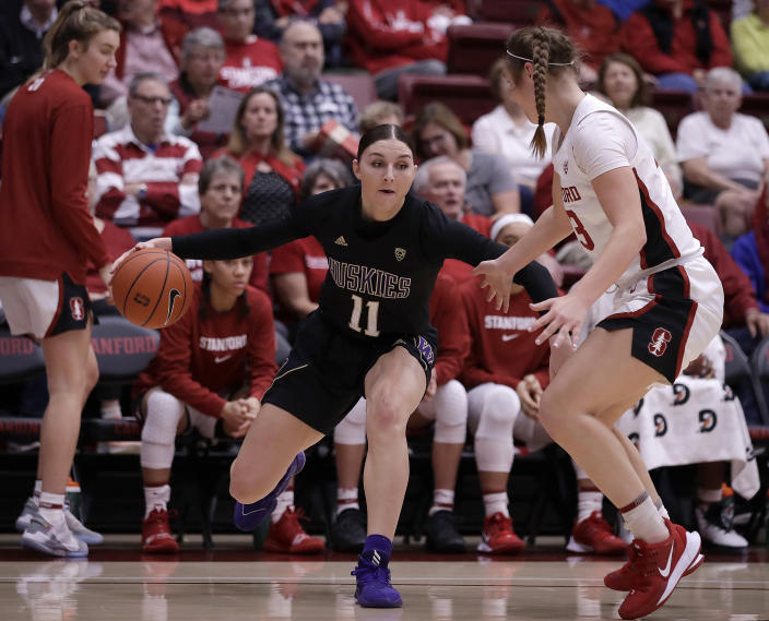 Washington's Haley Van Dyke, left, drives the ball against Stanford's Hannah Jump during the first half of an NCAA college basketball game Sunday, Jan. 5, 2020, in Stanford, Calif. (AP Photo/Ben Margot)