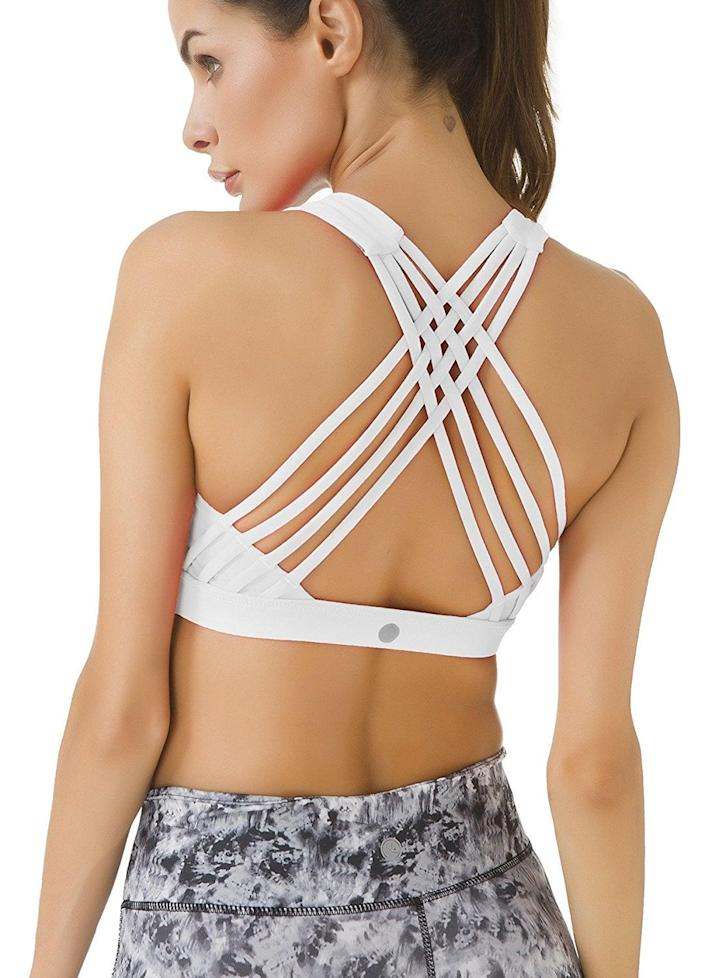 """<p><strong> The bra: </strong> <span>Queenie Ke Medium Support Strappy Sport Bra </span> ($10-$29)</p> <p><strong> The rating: </strong> 4.3 stars, over 1,600 ratings</p> <p><strong> Why People Love It: </strong> If you have a smaller or medium size bust, give this strappy choice a try. The chafe resistant and moisture-wicking fabric is ideal for sweaty workouts. This reviewer loved its quality and affordable price. """"This bra is so comfy and supportive, it feels like I'm not even wearing one at all. It's supportive enough where I'm not bouncing around during my workouts. I love the cute crisscross design in the back and also love that there's no underwire or clasps in the back. I have some lululemon sports bras too and these are a very similar quality for a fraction of the price!""""</p>"""