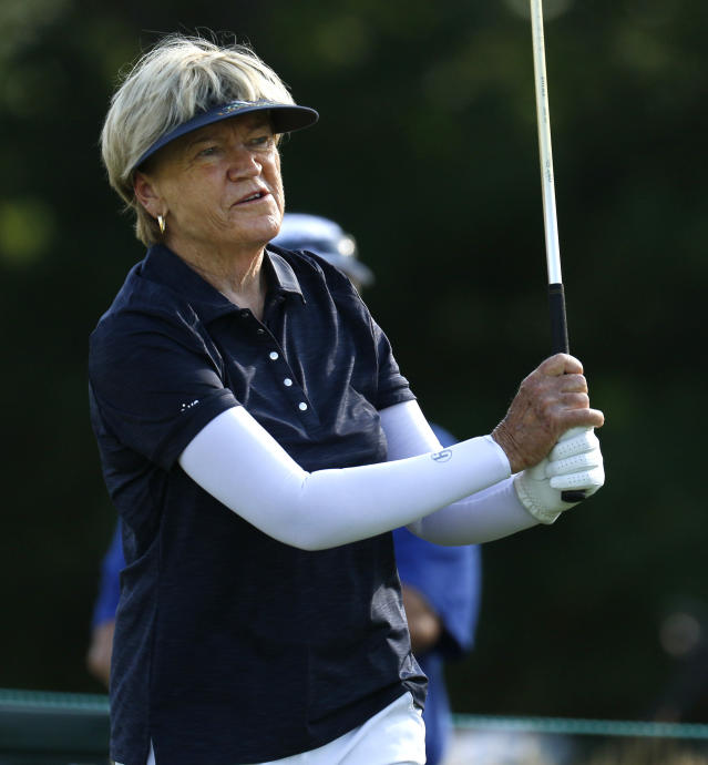 Jane Blalock watches her tee shot on second hole during the first round of the inaugural U.S. Senior Women's Open golf tournament in Wheaton, Ill., Thursday, July 12, 2018. (Daniel White/Daily Herald via AP)