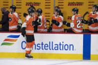 Philadelphia Flyers' James van Riemsdyk celebrates his goal with teammates during the first period of an NHL hockey game against the Pittsburgh Penguins, Wednesday, Jan. 13, 2021, in Philadelphia. (AP Photo/Chris Szagola)