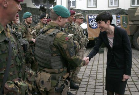 Norway's defence minister Ine Eriksen Soereidegreets a Norwegian soldier during a visit to the Very High Readiness Joint Task Force (VJTF) unit in Muenster, Germany, June 22, 2015.   REUTERS/Wolfgang Rattay/Files