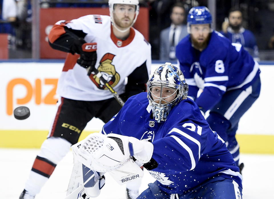Toronto Maple Leafs goaltender Frederik Andersen (31) makes a glove save during the first period of an NHL hockey game against the Ottawa Senators, Wednesday, Oct. 2, 2019 in Toronto. (Nathan Denette/The Canadian Press via AP)